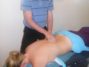 woman getting treatment from a chiropractor in Norwest