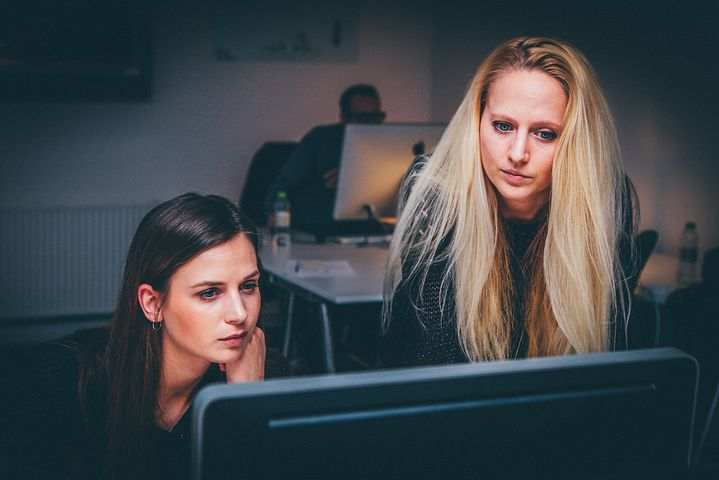 Two woman checking cert III in business