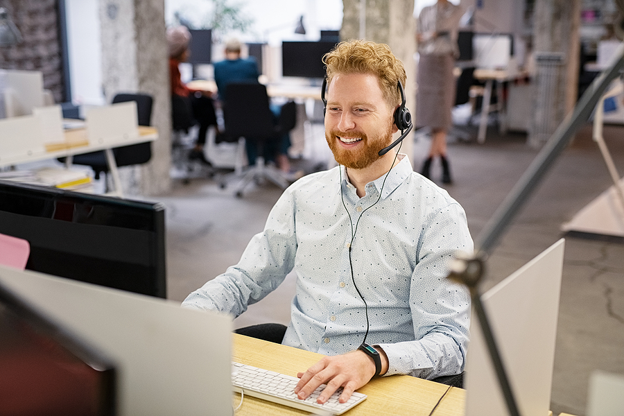 Male worker giving managed IT services