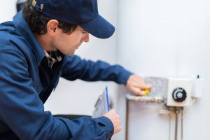 Hot water plumber in Canberra repairing a hot water system