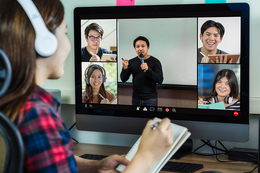 Group of workers joining an online team building